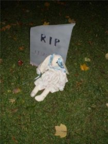 RIP with doll